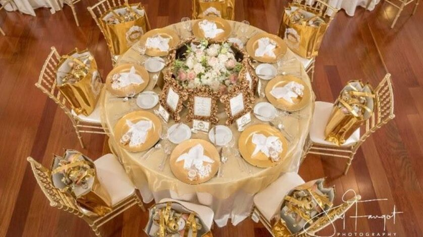 Image of a stunning gold decorated table ready for an event in the Grand Ballroom - Le Pavillon - Reception Venues in Lafayette La