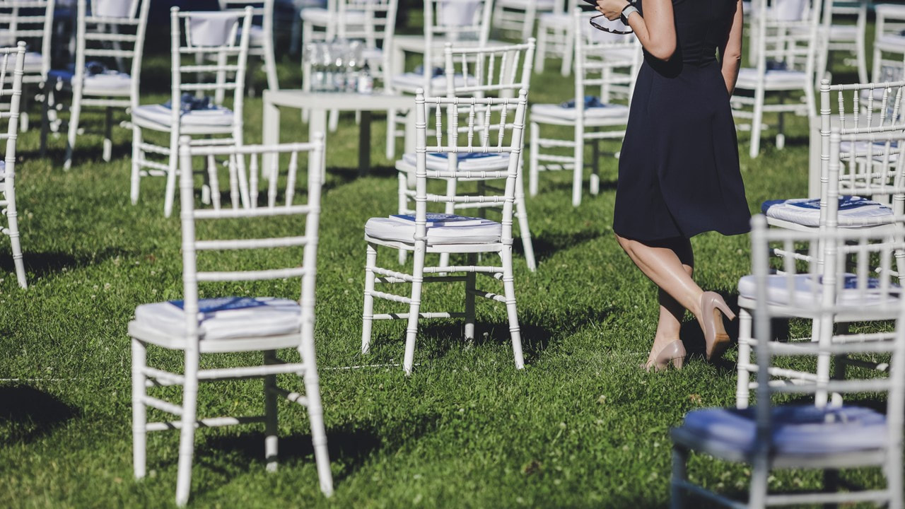 Outdoor private event with bamboo chairs spaced 6 feet apart - private event venues Lafayette La